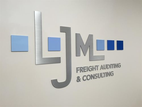 "LJM Freight auditing and consulting Sign wall 1/4"" thick custom, Water jet cut Natural Satin Aluminum and Laset Cut 1/4"" plexi / acylic Logo , custom"